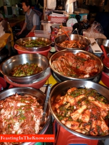 Korean market scene.  Kimchi stall.