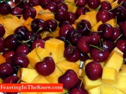 Mangoes and cherries.  Sweet fruit..