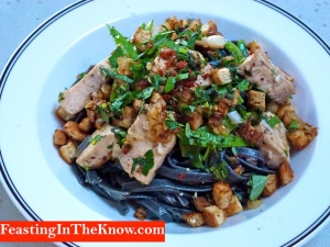 Squid ink linguine with seared fish