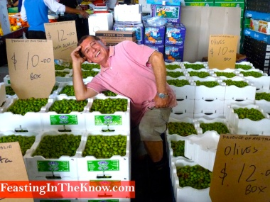 Italian selling olives at Flemington market farmers markets produce